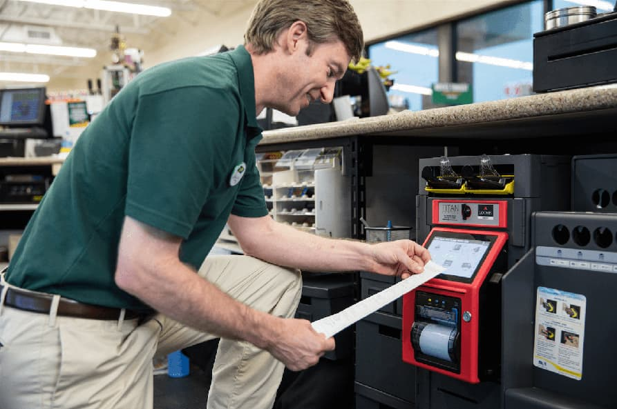 Convenience store operator views deposit slip from Titan smart safe